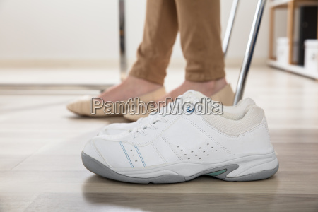 womans sport shoes in office