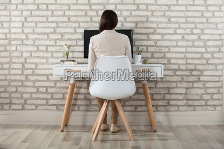 businesswoman sitting in front of computer