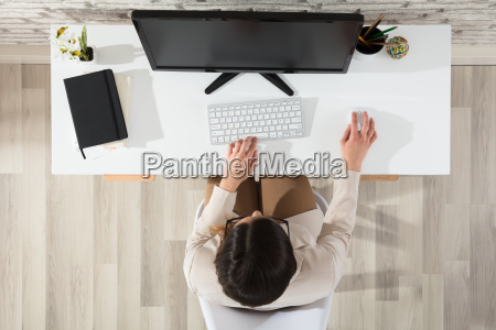 woman using computer in office