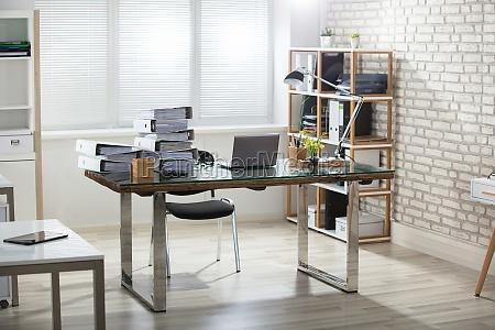 stack of folders on office desk