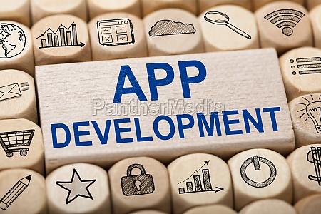 app development text on wooden block