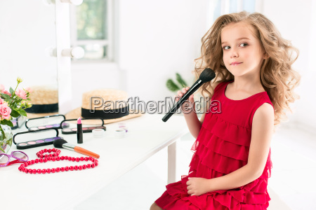 a little girl with cosmetics she