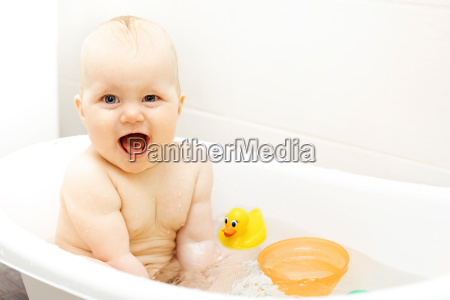 happy excited baby taking a bath
