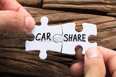 haende verbinden auto teilen puzzleteile