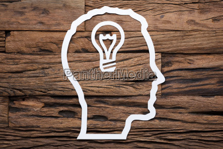 paper businessmans head outline with light