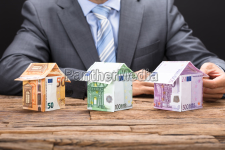 making houses from euro paper currencies