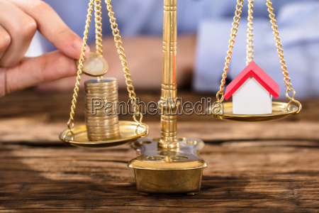 person protecting justice scale with coins