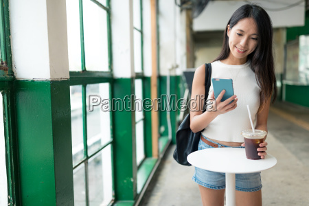 woman using cellphone and enjoy her