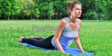 young woman during yoga meditation in