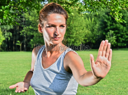 young woman during tai chi exercise