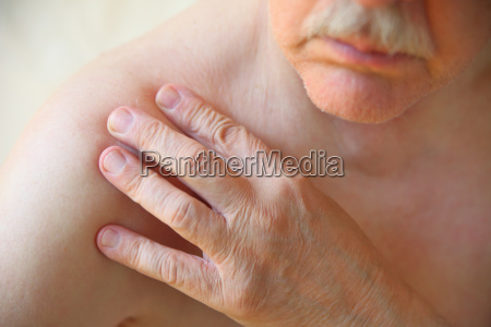 older man has ache in shoulder