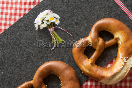 pretzel with red checkered tablecloth on