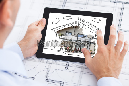 businessman holding blank digital tablet over