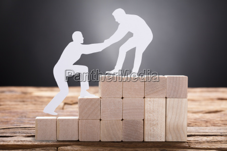 businessman pulling colleague while standing on