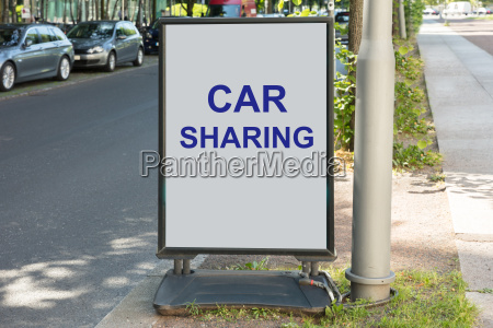 car sharing sign on board by