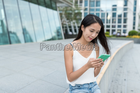 woman using mobile phone in the