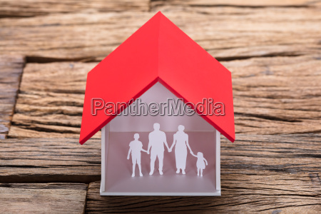 paper family in house model on