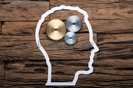 paper businessmans head outline with metallic