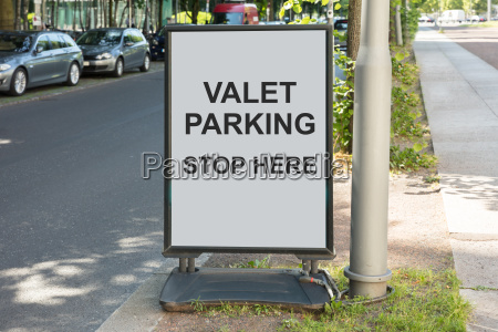 valet parking sign on board by