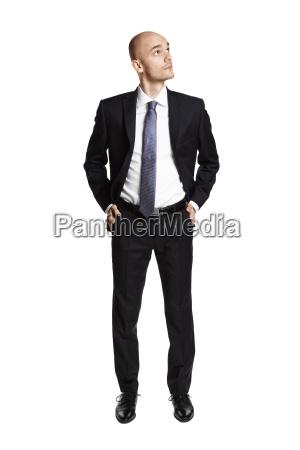man in black suit looking left