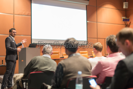 business speaker giving a talk at