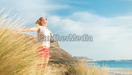 free happy woman enjoying sun on