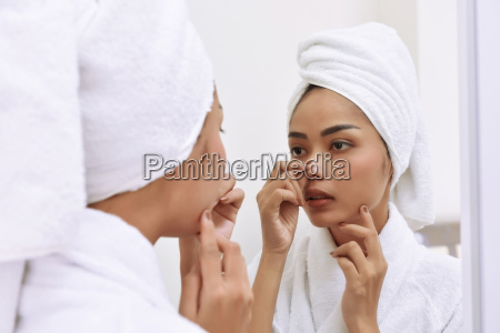 young asian woman with bath towels