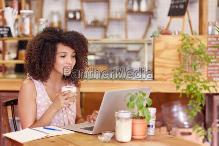 female freelancer working in a coffee