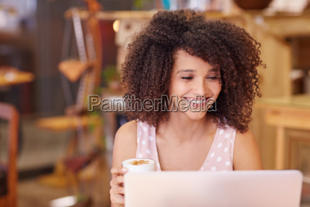 mixed race woman using her laptop