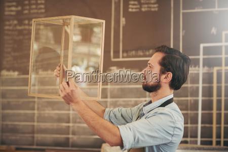 crafstman entrepreneur inspecting a new wood