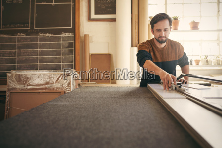 man working at his workbench with