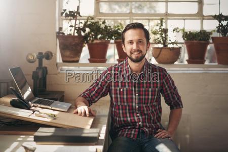 confident entrepreneur designer sitting in his
