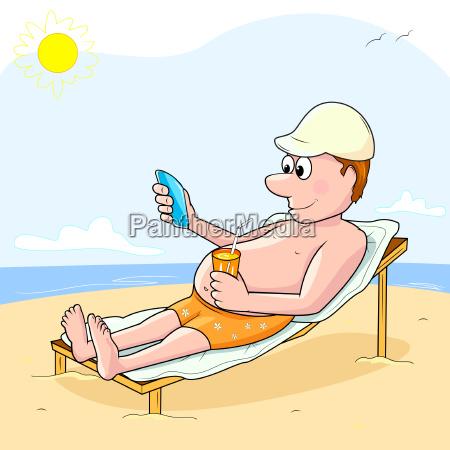 man with phone on the beach