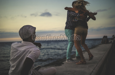 two people dancing on a sea