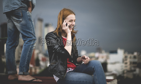 a woman sitting and talking on