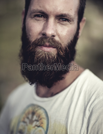 portrait of bearded man wearing printed