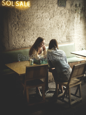 two young women sitting at a