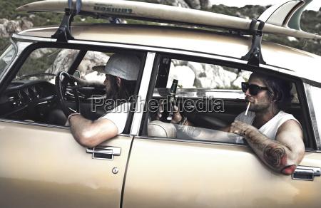 two men in a vintage car