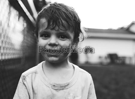 portrait of young boy with dirty