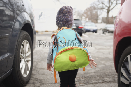rear view of young girl carrying