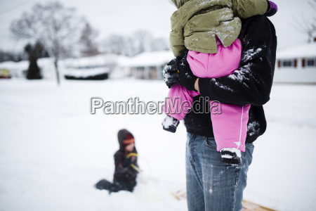 man holding young girl wearing pink