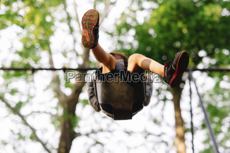 low angle view of boy sitting