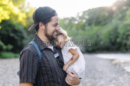 smiling bearded man wearing baseball cap