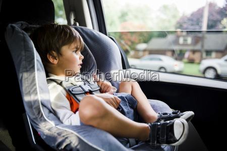 a boy child sitting in a