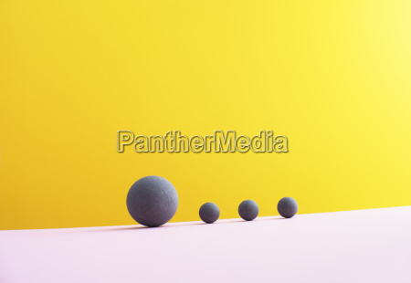 four spheres against yellow background 3d