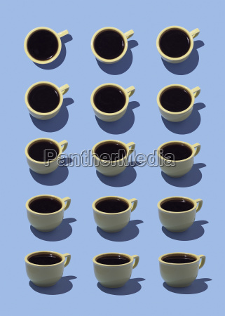 yellow coffee cups on light blue