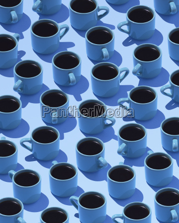 blue coffee mugs on light blue