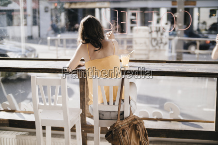 woman sitting in cafe writing the