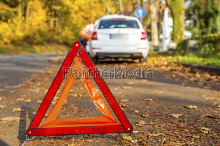 warning triangle on the road by