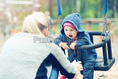 mother and child having fun in